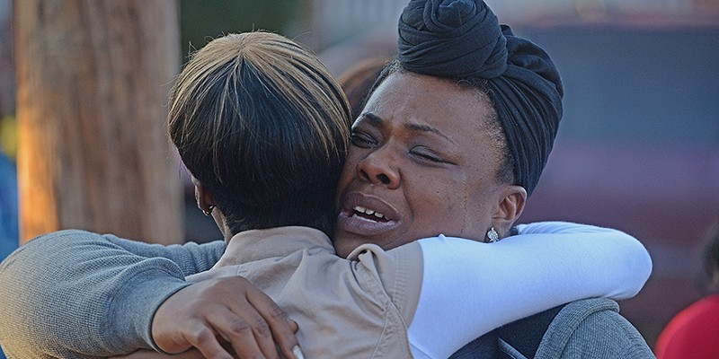 Scenes from the Vigil for Randy Smith Jr. Markeita Boyd comforts Laquinta Lockhart, the mother of Smith's unborn child.