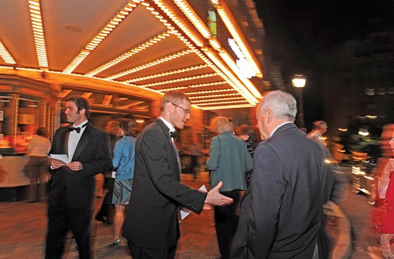 Martin Gordon, left, and Tom Schneider, both bassoonists with the Richmond Symphony Orchestra, pass out leaflets explaining the musicians' stance before a Sept. 29 concert at CenterStage. - SCOTT ELMQUIST