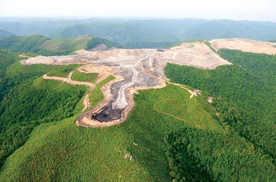 Massey's mountaintop removal surface mining rips apart thousands of acres of hills. - SCOTT ELMQUIST