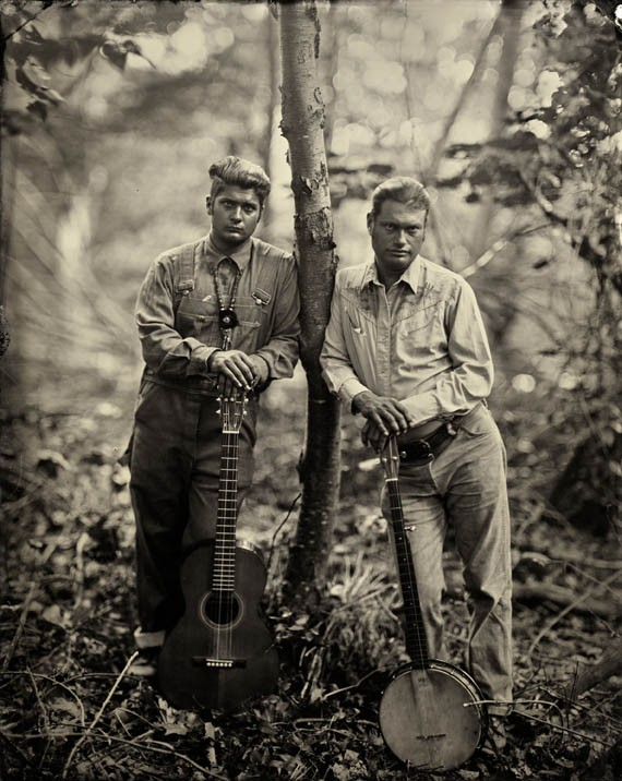 """""""Matthew Kinman and Moses Nelligan, Clifftop, WV"""" is one of the photos by Lisa Elmaleh featured in the """"American Folk"""" exhibit at Candela Gallery. Kinman (Roan Mountain Hilltoppers) and Nelligan are modern practitioners of old-timey folk music."""