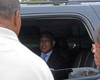 Mayor Dwight Jones arrives at his house, next door to an Occupy Richmond encampment.