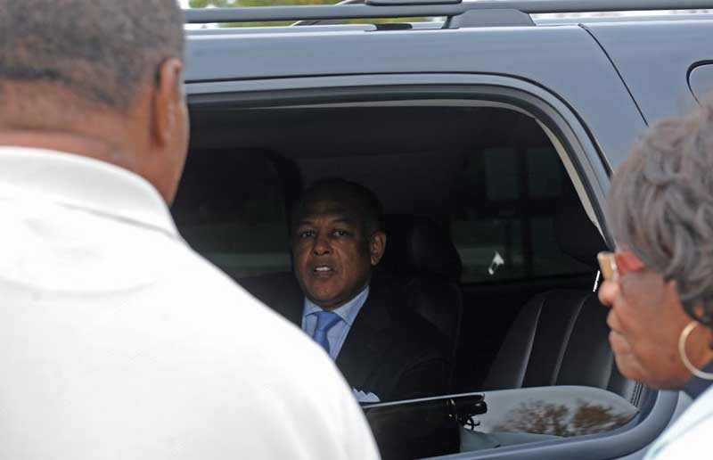 Mayor Dwight Jones arrives at his house, next door to an Occupy Richmond encampment. - SCOTT ELMQUIST