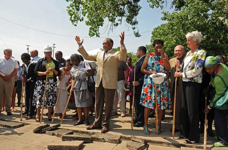 Mayor Dwight Jones leads a celebratory reclaiming in May of the long-lost African Burial Ground in Shockoe Bottom, believed by some to lie underneath asphalt long used as parking lot.