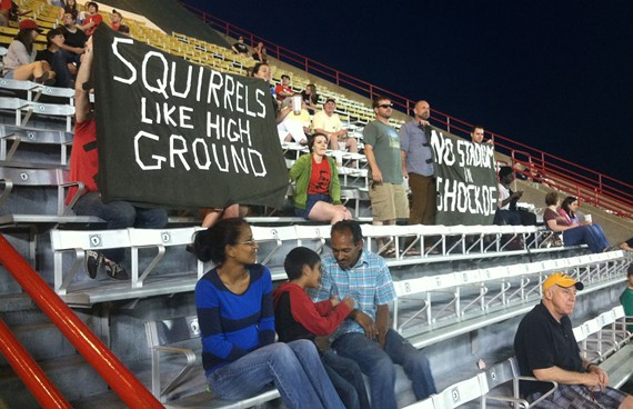 Members of Collective X hold banners at a recent Squirrels' game. - NED OLIVER