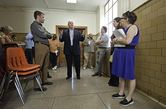 Members of the Richmond Public Schools task force see conditions of buildings firsthand, including at George Mason Elementary, on a tour led by Tommy Kranz.