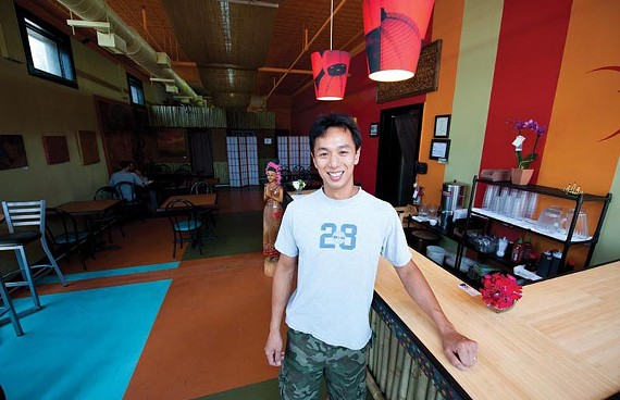 Michael Ng, whose tongue-in-cheek business card lists his blood type as MSG, is a Hong Kong native whose Thai-born wife helps run the new Thai Corner in Jackson Ward. - SCOTT ELMQUIST