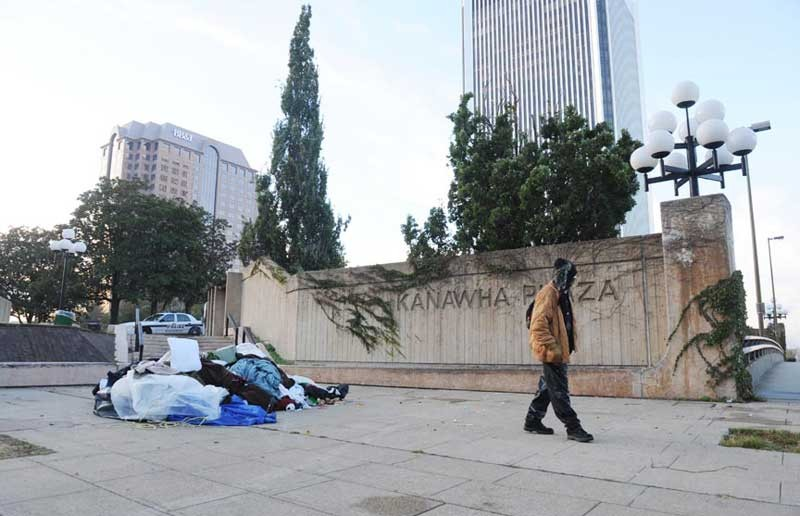 Mingo Coleman, who is homeless, searches for his bicycle after police raided the Occupy Richmond encampment at Kanawha Plaza on Oct. 31. - SCOTT ELMQUIST