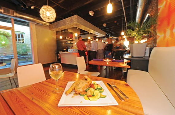 Modern interior décor mixes well with the updated menu at 2113 in Shockoe Bottom; here, roasted chicken is accompanied by carrots, squash, mushrooms and zucchini in an herb sauce. - SCOTT ELMQUIST