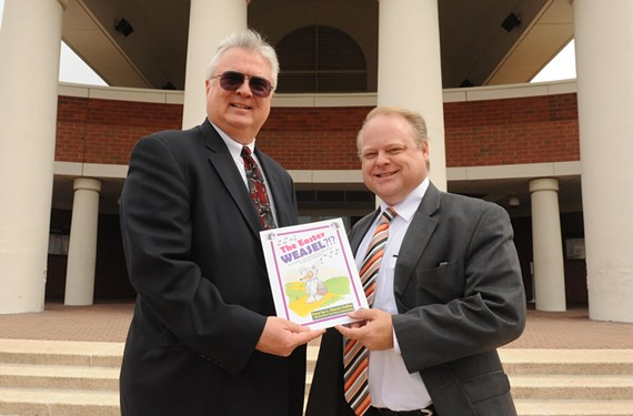 """""""Most people don't even know where the Easter Bunny comes from,"""" says Chesterfield defense attorney Stephen Armstrong (right) and longtime prosecutor Dennis Collins, shown here holding up a copy of their children's book, """"The Easter Weasel."""" - SCOTT ELMQUIST"""