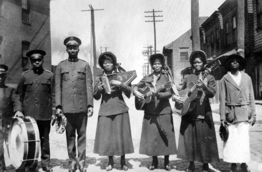 Musicians in the St. Luke Band, part of the Independent Order of St. Luke organization established by Richmond entrepreneur Maggie L. Walker, pose in a Richmond street in an undated photograph. - COPYRIGHT RICHMOND IN SIGHT