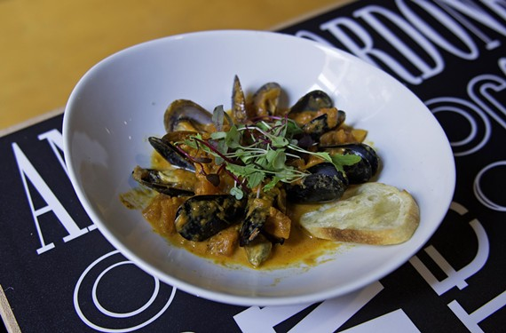Mussels served in tomato-saffron sauce are among a number of seafood tapas at Torero, including clams, shrimp fritters and tuna tartare. Vegetarian and meat options also fill the menu.