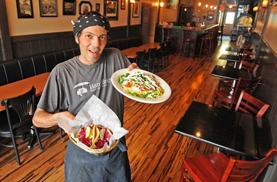 Nate Gutierrez shows the fish tacos with lime cabbage slaw and the green chile chicken enchiladas that have earned him a cult following. - SCOTT ELMQUIST