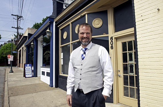 Nathan Hughes is outside a restaurant next to his Museum District office that is about to become a new sushi restaurant from Akida owner Kevin Mak.  Hughes brokered the deal, among many other local restaurant transactions.