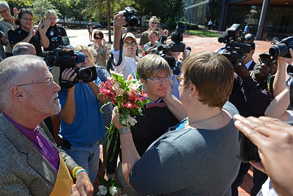 Nicole Pries and Lindsey Oliver exchange vows outside the court house in Richmond on Monday four hours after the Supreme Court ruled it would not intervene in a lower court's decision to overturn the state's gay marriage ban.