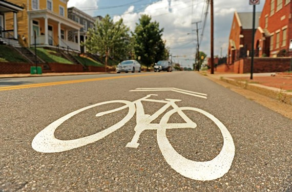 No. 36 Be vigilant. A sharrow, as such signs painted on the road are known, on West Leigh Street in Carver guides bicyclists and urges motorists to share the road. - SCOTT ELMQUIST