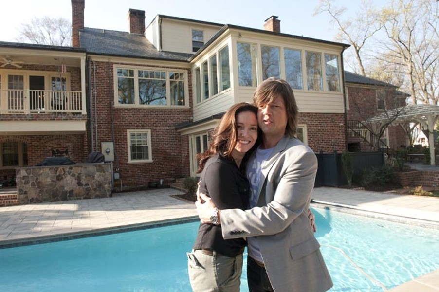 Norman at home with his wife, Deirdre. They live in Windsor Farms with their four children: Holt, 16, Annabelle, 14, Pierce, 11, and Daisy, 9. The backyard includes a pool and a small pond where Norman is proud to have caught catfish. - SCOTT ELMQUIST