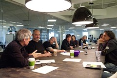 Norman, fourth from the left, leads a meeting of The Martin Agency's group creative directors, including, clockwise from left, Steve Bassett, Keith Tilford, Eric Tilford, Joe Alexander, Nancy Hannon and Andy Azula. - SCOTT ELMQUIST