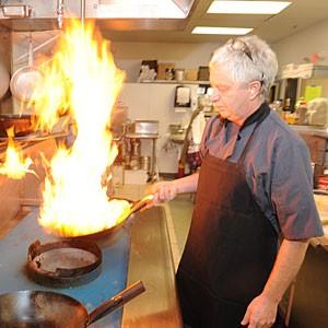 Nuccio Giambanco demonstrates the flaming pasta-in-a-wok technique at his new Osteria la Giara in Short Pump.