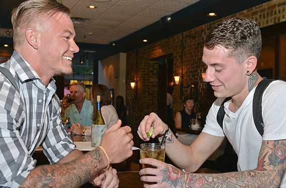 On a Friday night shift at Sam Miller's last week, Casey West serves his fraternal twin tyler on his night off as a bartender at Cha Cha's Cantina. - ASH DANIEL