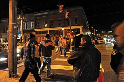 On a recent Saturday night, East Main Street hops. Despite two homicides earlier this year, major crime in the Bottom has dropped nearly 50 percent in the last five years. - SCOTT ELMQUIST