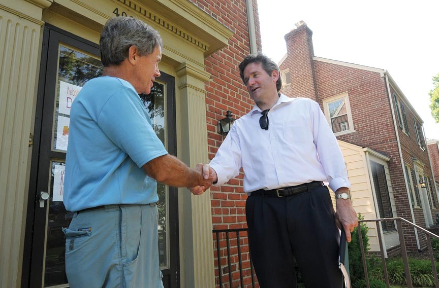 On Sunday, Charles Pond chats with City Council candidate Jon Baliles, who spent part of the afternoon collecting signatures on Stuart Avenue. - SCOTT ELMQUIST