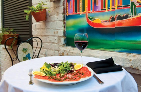 On the patio at Maximo's, beef carpaccio is paired with a Martinez Lacuesta crianza rioja. - SCOTT ELMQUIST