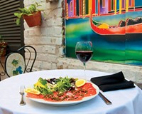 On the patio at Maximo's, beef carpaccio is paired with a Martinez Lacuesta crianza rioja.