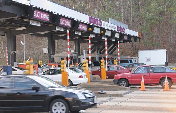 Once the debt is paid on the Downtown Expressway and Powhite Parkway (pictured), the city will own the toll road. But it won't be in 2022, as originally expected. - SCOTT ELMQUIST/FILE