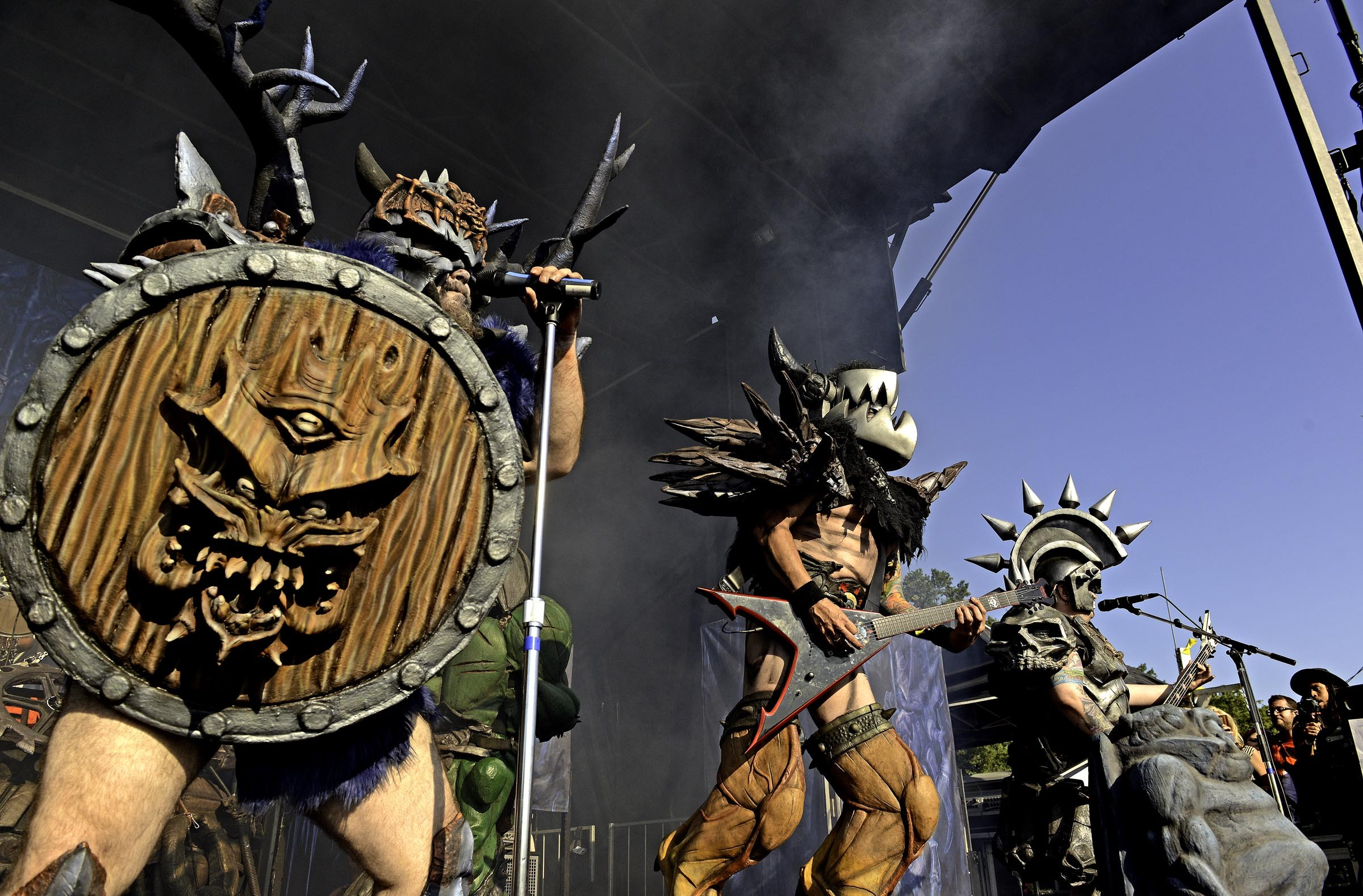 onstage at Gwar B-Q, thrilling fans with the emergence of Bishop's new Norse-mythology-inspired character, Blothar (far left). Beside him is rhythm guitarist Balsac the Jaws of Death (Mike Derks) and bassist Beefcake (Jamison Land). - SCOTT ELMQUIST