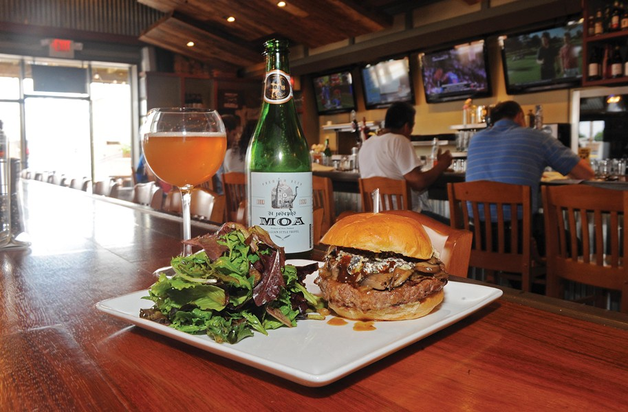 Owner Michael Ripp says the health benefits of New Zealand beef make his Carytown business a conscious move. Here, the Wellington burger is loaded with mushrooms, onions and New Zealand blue cheese; the beer is a Moa St. Joseph's tripel, also from New Zealand. - SCOTT ELMQUIST