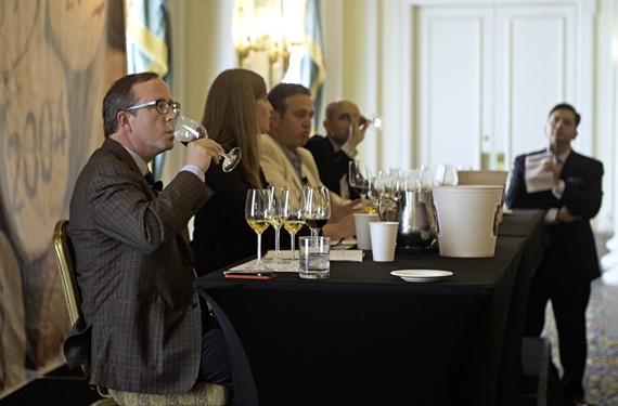 Panelist John T. Edge of the Southern Foodways Alliance tastes the Williamsburg Winery's 2010 Adagio at the Virginia Wine Summit.