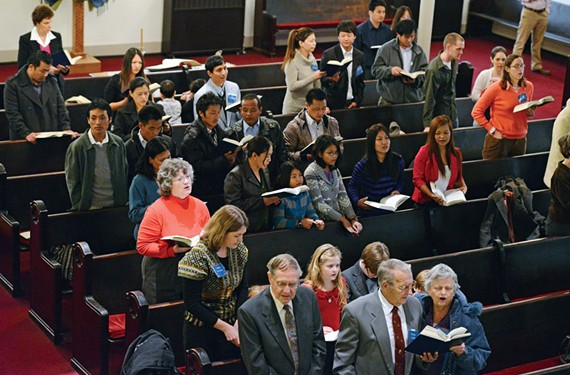 Parishioners sing a hymn during a Sunday worship service at Tabernacle Baptist Church. - SCOTT ELMQUIST