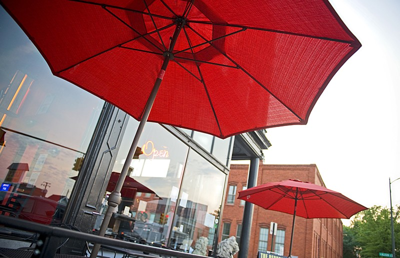 Patrons can watch a Broad Street parade of cars and humanity while dining outside the Republic, which just opened its new sidewalk space. - ASH DANIEL