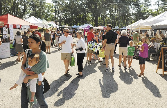 Patrons stroll through the South of the James Market at Forest Hill Park. - SCOTT ELMQUIST
