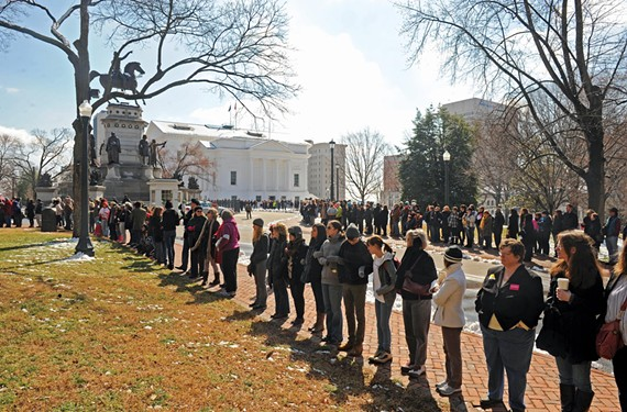 Perhaps the seminal moment in this year's abortion debates came on Feb. 20 when 1,000 pro-choice supporters lined the sidewalks at the state Capitol for a silent protest. - SCOTT ELMQUIST