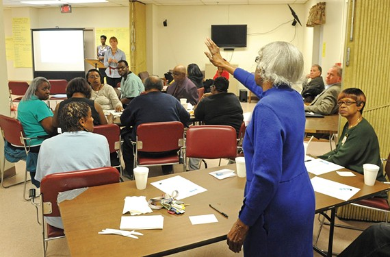 Perlea Robert and other Highland Park residents question housing authority officials last week at about the future of the former Dove Court housing project. - SCOTT ELMQUIST