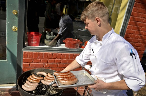 Phillip Perrow grills hot dogs for the restaurant's popular Saturday takeout. - SCOTT ELMQUIST