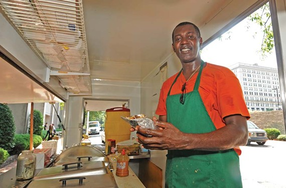Philmore Moses operates Caribbean Grill, a downtown food cart that attracts a faithful following for its authentic island flavors. - SCOTT ELMQUIST