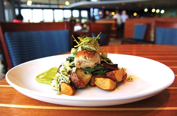 Photogenic food at the Boathouse Rocketts Landing includes tilefish with lump crab relish, chard, coriander-fried potatoes and avocado purée.