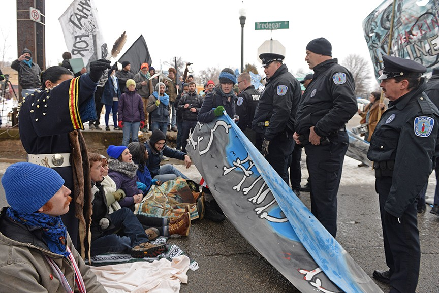 Police made one arrest and issued nine summonses after a group of protesters refused to clear the road leading to Dominion Resource's headquarters on the James River. - SCOTT ELMQUIST