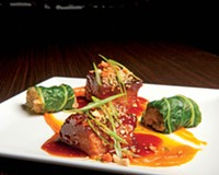 Pork belly smoked in bourbon barrels from Hardywood Park is served with puréed butternut squash rolled in bok choy with kimchi, a treat at Heritage in the Fan.