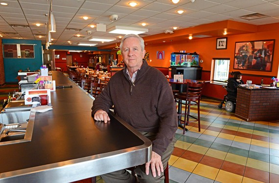 Positive Vibe Cafe's Garth Larcen invited UR's basketball coach Chris Mooney to face off against Virginia Tech's coach Buzz Williams in a cooking competition on April 23.