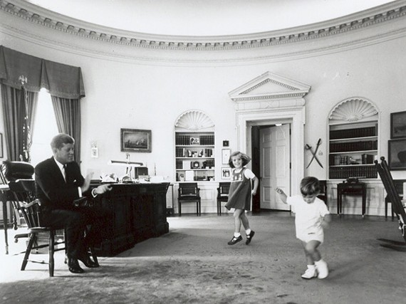 President Kennedy with his children, Caroline and John Jr. in the Oval Office of the White House on October 10th, 1962. - CECIL STOUGHTON, WHITE HOUSE / JOHN F. KENNEDY LIBRARY