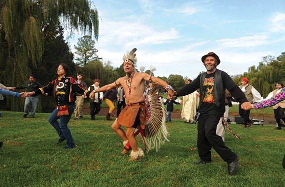 Preston Adkins of the Chickahominy tribe leads a friendship dance during the First Thanksgiving Festival at Berkeley Plantation in Charles City County. - SCOTT ELMQUIST