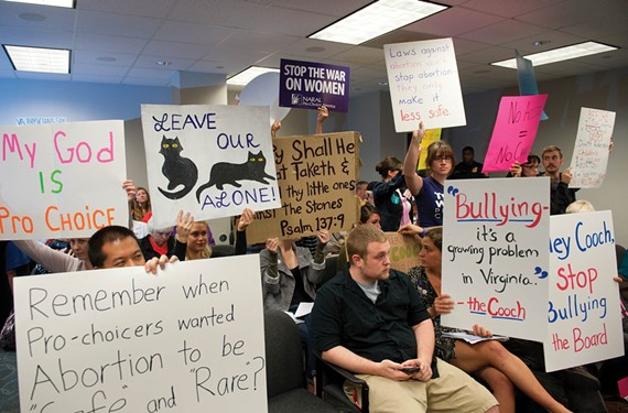 Pro-choice activists sat in silent protest during a Virginia Board of Health meeting Sept. 14, when the board upheld key provisions of the new abortion clinic regulations. - SCOTT ELMQUIST