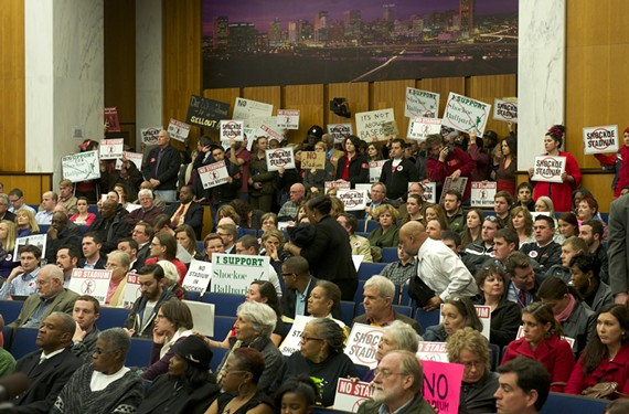 Protesters against the mayor's plan to redevelop Shockoe Bottom around a baseball stadium jammed the City Council chamber on Feb. 24.