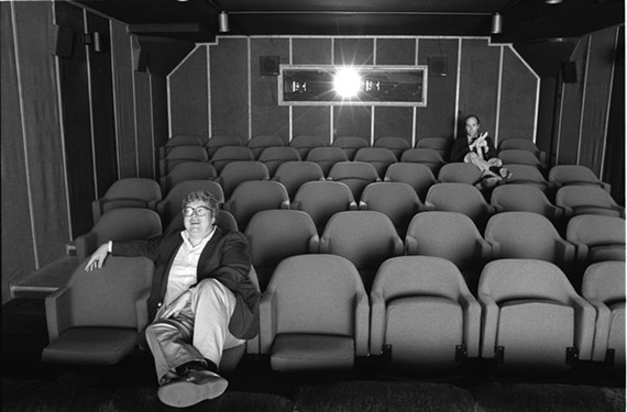 "Pulitzer Prize winner Roger Ebert, seated front, with his verbal sparring partner, Gene Siskel, had a contentious relationship as the country's most popular film critics — both died from cancer. Ebert's life is explored in the new documentary by Steve ""Hoop Dreams"" James."