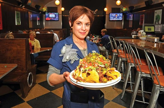 Rachel Velvikis delivers a typically outsized platter of nachos with beef brisket at The Continental Westhampton. - SCOTT ELMQUIST