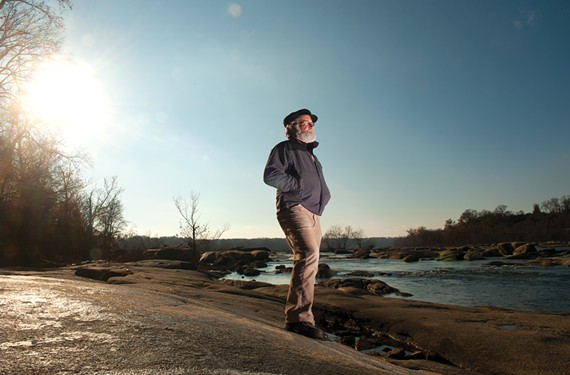 Ralph White, standing atop Dead Rock at Belle Isle where the Grateful Dead partied after a concert in the 1970s, worries about the river park's future. - SCOTT ELMQUIST