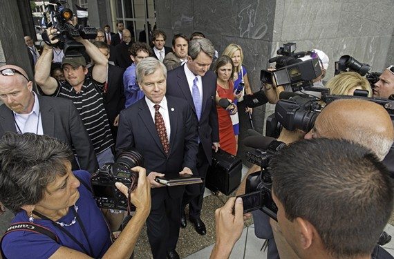 Reporters surround former Gov. Bob McDonnell as he leaves the Richmond federal courthouse.